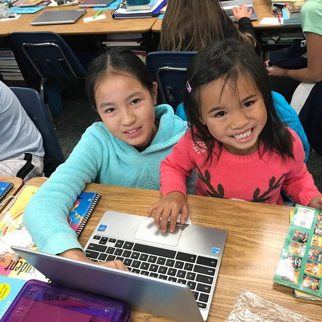 These first graders learn how to code from the best teachers around: their fellow sixth graders!